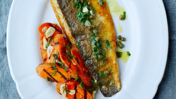 Sea bass and capers with butter sauce, served with grilled carrots marinated in garlic and white wine vinegar