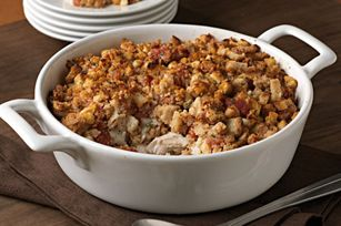 Chicken stuffing bake 14-1/2 oz diced tomatoes, undrained 1 pkg/2c STOVE TOP 1/2 c water 2 garlic, minced 1-1/2 lb. chicken breast cut into pieces 1 tsp. basil 1 c Shred Mozz Cheese oven to 400ºF. Mix tomatoes, stuffing, water and garlic until stuffing is moistened.  Place chicken in 3-qt. casserole sprayed with cooking spray; sprinkle with basil and cheese. Top with stuffing. Bake 30 min