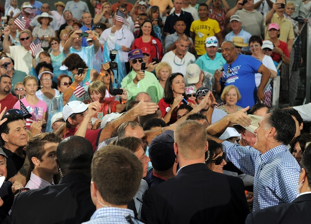 98 10/15/12 US Republican presidential candidate Mitt Romney, right, greets supporters during a campaign rally in Port Saint Lucie, Florida, on October 7, 2012.