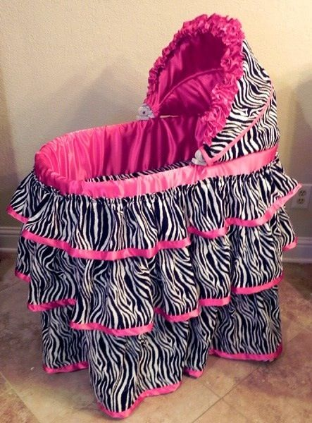 If I could go back in time I'd give you this for Arlettas baby shower.... to store cute zebra print clothes in of course, since we're crazy and have a bed full of babies instead of bassinets! : )