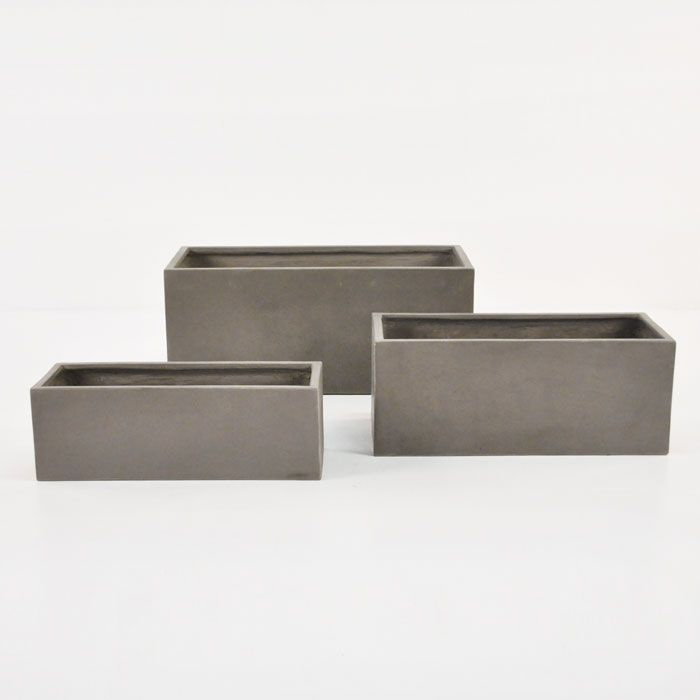 These raw concrete planter boxes, available in 3 different sizes, bring minimalist style to your indoor or outdoor room.