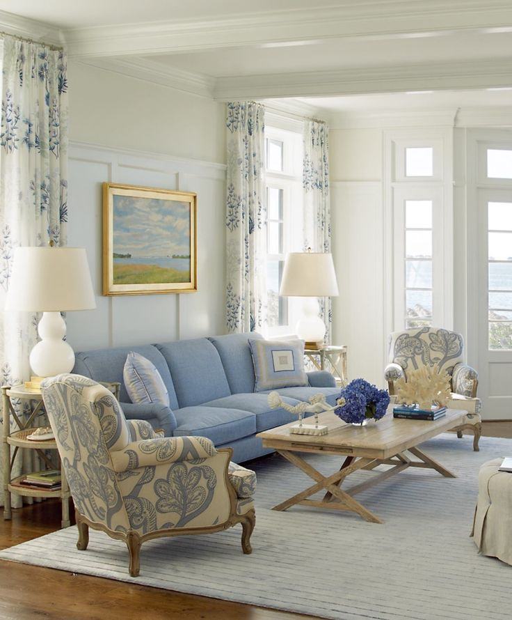 color palette especially the sofa and chair and the style of the chair cottage blue living room