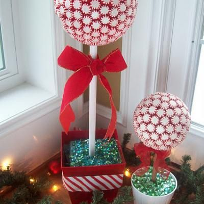 "10""  STYROFOAM™ Brand Foam sphere  6"" STYROFOAM™ Brand Foam cube  Pot or container for the base  Peppermint candies, about 4 1/2 11-oz bags  Red duct tape  1"" dowel  Decorative accents and ribbon as desired"