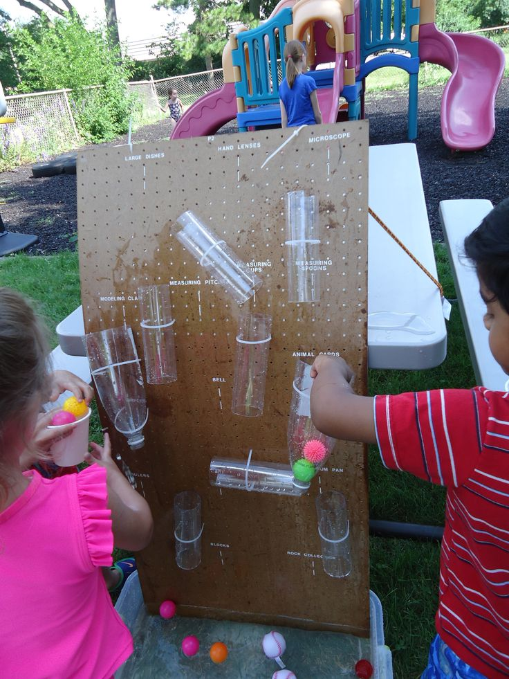 Water Wall: We attached tubes and plastic bottles with zip ties to a peg board. We put the bottom in a big plastic tub with water, cups, and balls of various types and sizes. The children had fun pouring water, dropping balls through and also seeing that some balls didn't go though and blocked the flow of water.