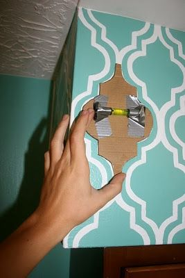 Taping a mini-level to the stencil is genius! Would have come in handy when completing our wall :)