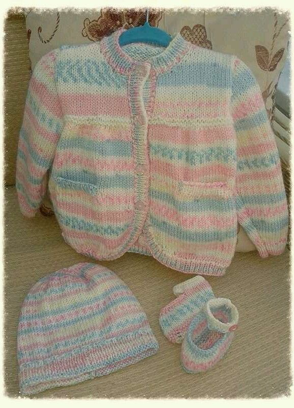 Hand knitted baby cardigan set.