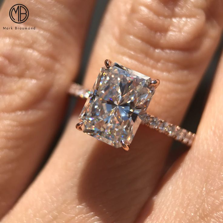 Don't settle for anything less than magic. Elongated radiant engagement ring by Mark Broumand.