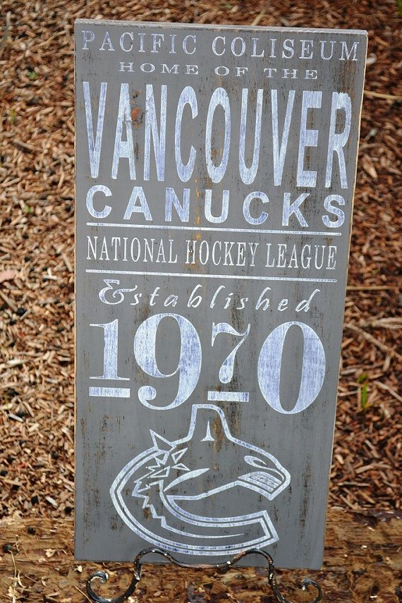 Vancouver Canucks Hockey wood sign  Established by DollickDesigns. , via Etsy. $49.99