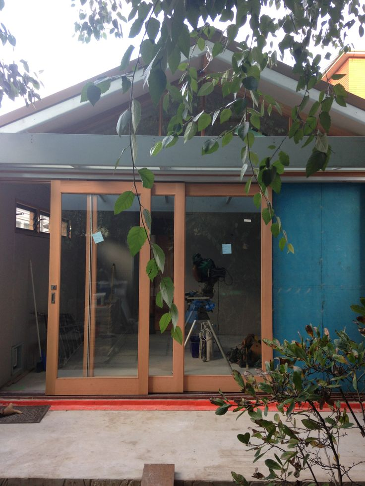 Roof on, fascias and eaves installed, windows and doors installed and plastering underway and verandah framework built.