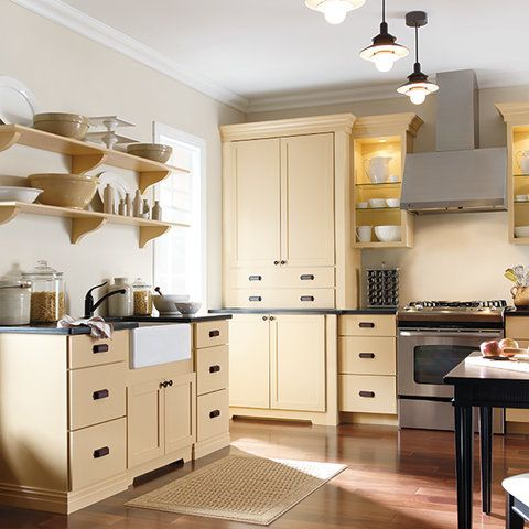 This country kitchen features Maidstone PureStyle™ kitchen cabinets in Fortune  Cookie finish, from Martha