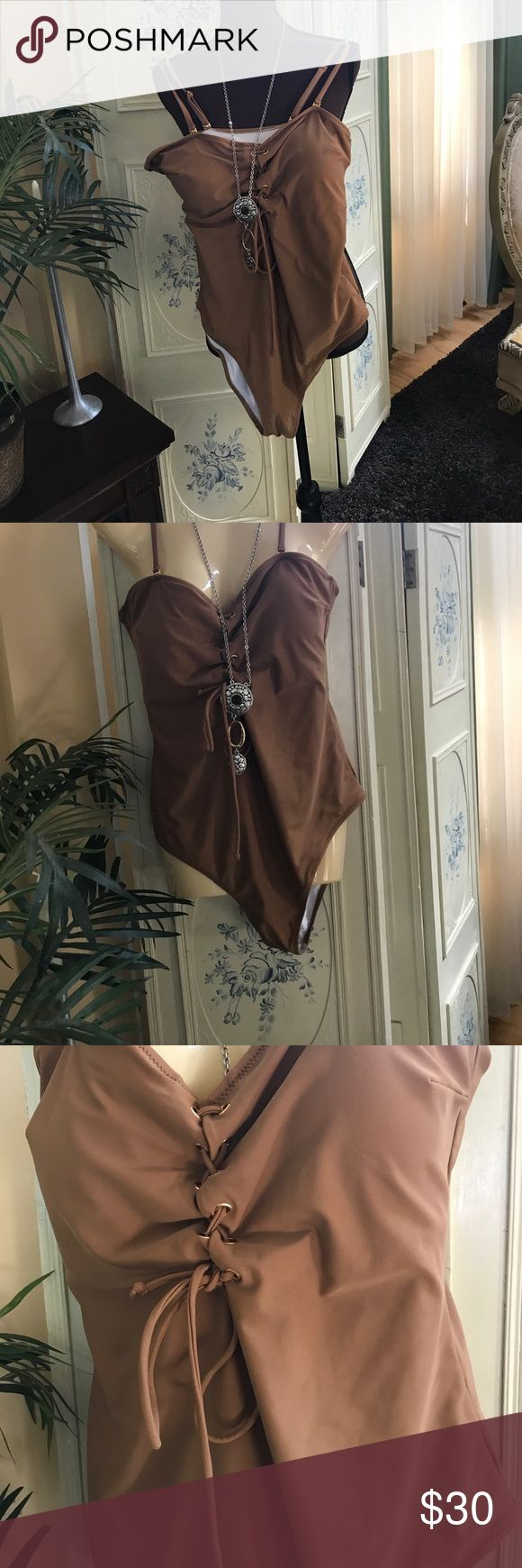 Brown one piece bathing suit L Brand new bathing suit brown with gold hardware. Padding in front.  Very nice color with the gold. Size large Swim One Pieces