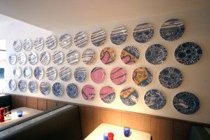 A mural design made up of plates for Pizza Express restaurant in Horsforth. Tiled Space worked with Baynes & Co. to produce this stunning piece of art.