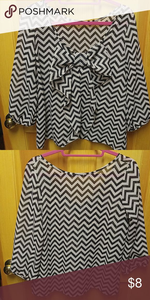 Bow back chevron top Cream and black chevron top, 3/4 sleeves. Very flattering. Tops