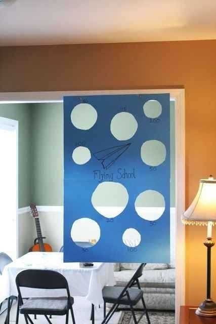 Hang a target for paper airplanes. This is supposedly for children. I LOVE THIS AND I'M AN ADULT.