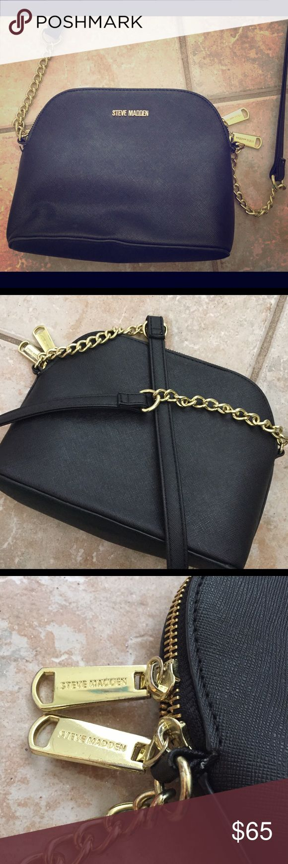 STEVE MADDEN Black Crossbody Gold Purse Handbag STEVE MADDEN Barely ever worn, black, crossbody women's handbag purse with gold zip up detail. Perfect for any occasion. Actually fits quite a bit! Can fit a phone, charger, and large wallet along with many other small items very easily. No scuffs or scratches on outside or tears in the inner material. Steve Madden Bags Crossbody Bags