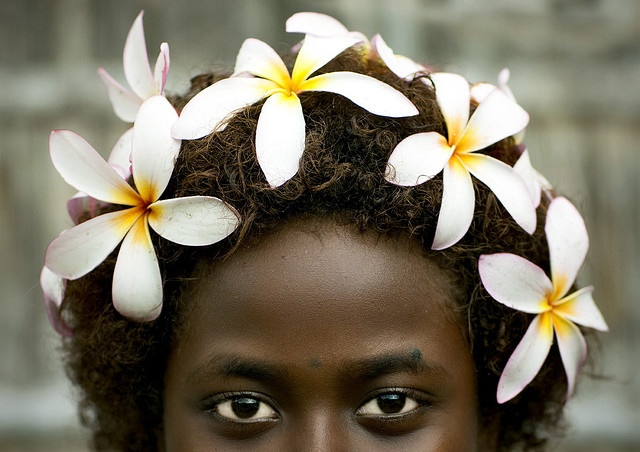 Bougainville girl and frangipan headress in Papua New Guinea by photographer Eric Lafforgue