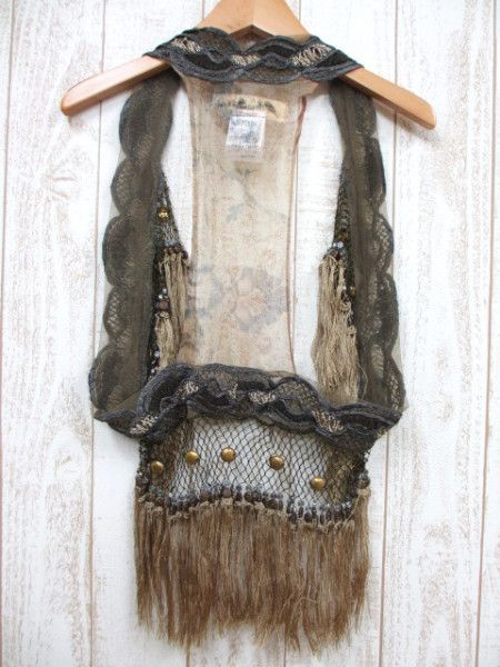 Hmmmmm. A fancy scarf sewn into a circle. Add sheer, netting, fringe, studs. Great looking item and light enough for daytime use.