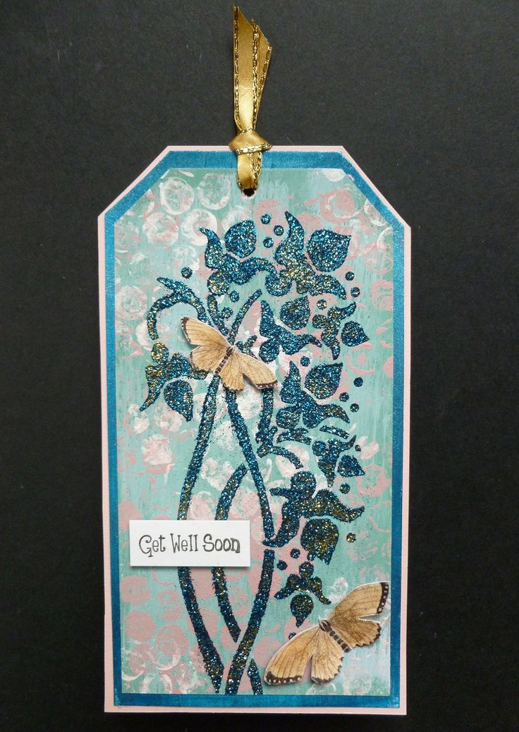 'Get Well Orchid Trio' Tag. - Imagination Craft's - Duck egg Rusty Patina.  Clover MDF paint.  White gold & Blue Starlight paints.  White Gesso.  Golf shine & Teal Sparkle Mediums.  Orchid Trio panel stencil.  Rice paper no. 196.  Decoupage glue.  Metal spatula.  Black ink pad.  Bubblewrap.  April 2017.   Designed by Jennifer Johnston.
