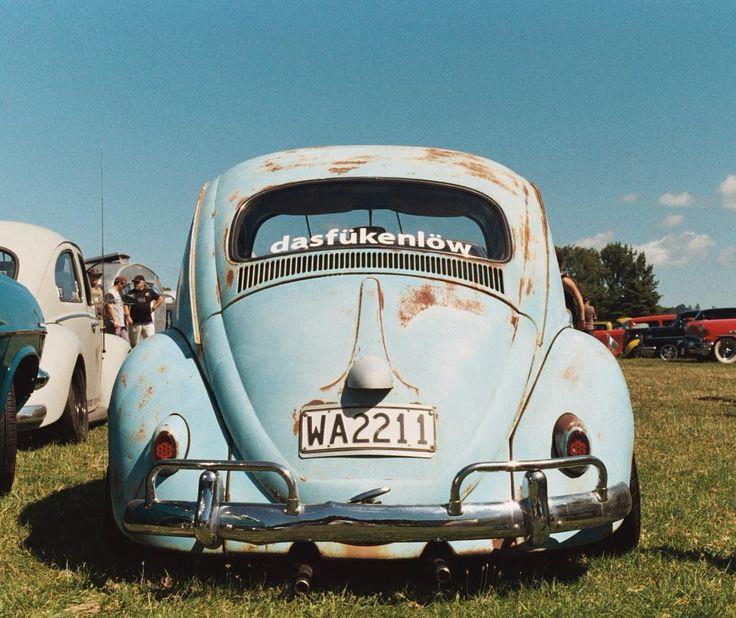 Adorable duck-egg blue vintage VW Beetle in the summer sunshine