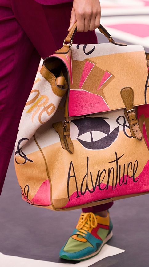A runway close-up: The Travel Satchel in illustrated print The Field Sneaker in leather and mesh