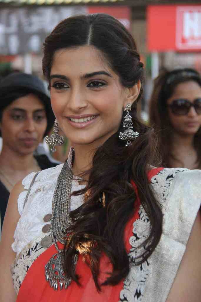 Sonam Kapoor in a modern-woman's Anamika Khanna sari, at the Hello Cup Derby