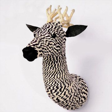 Packed with color and charming personality, this Rope Wrapped Deer Mount by C.G. Sparks challenges the notion that a cozy cabin requires authentic animal souvenirs. Made of meticulously wrapped recycled rope and topped with wood-based antlers, this imaginative accent lets you keep that exotic ambiance without the guilt.