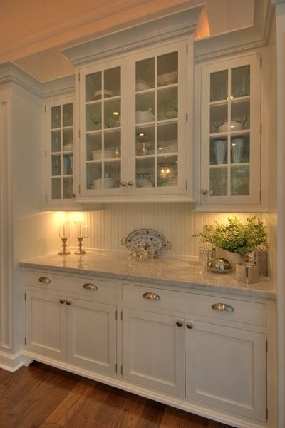 marble, bead board, white cabinets and glass doors