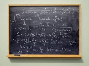 Formulas on a blackboard - Jon Boyes/Photographer's Choice RF/Getty Images