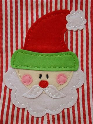 Felt Santa face.  Translate to painted paper boxes?