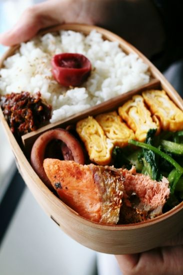 Traditional Japanese Bento Boxed Lunch (Umeboshi Pickled Plum on Rice, Grilled Salmon, Tamagoyaki Egg Omelet, Pan-Fried Calamari Ring, Veggies)