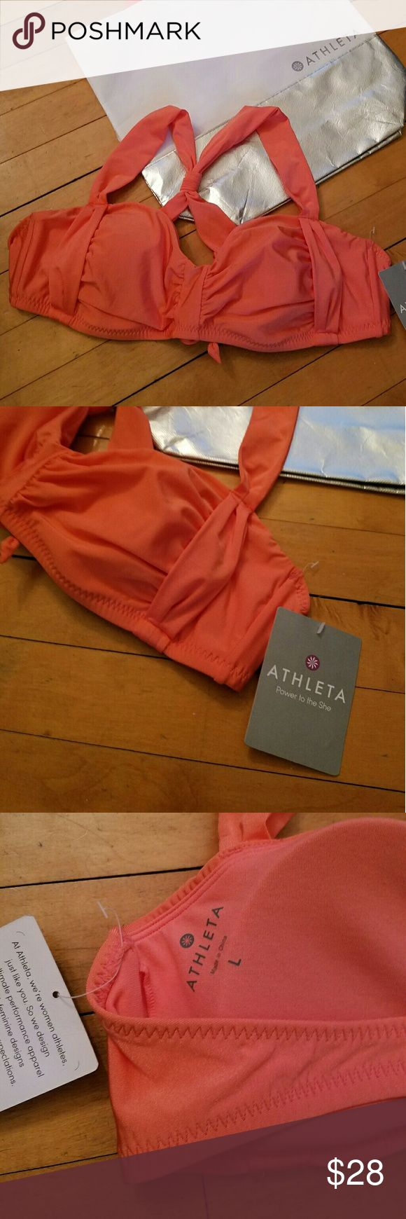 NWT Athleta Aqualuxe Swim Top NWT Athleta Aqualuxe Swim Top  Cut from signature, shimmering AquaLuxe fabric for moisture-wicking performance and a luxuriously soft feel, this bandeau bikini top features removable cups for adjustable coverage. A sweetheart neckline flatters the d?colletage. AquaLuxe swim fabric provides moisture-wicking stretch and metallic luster UPF 50+ Removable cups Adjustable ties Nylon / spandex Light coral color, size L. Bag not included Athleta Swim