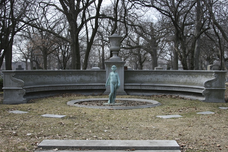 """Vehon Family Memorial at Rosehill Cemetery - monument features an exedra - curving benches inscribed with the words, """"Until the Day Break  And the Shadows Flee Away"""" - In the center is a fountain in which stands a small girl of bronze.  (The fountain has since been filled in.)  Members of the Vehon family buried here died between 1902 and 1930."""