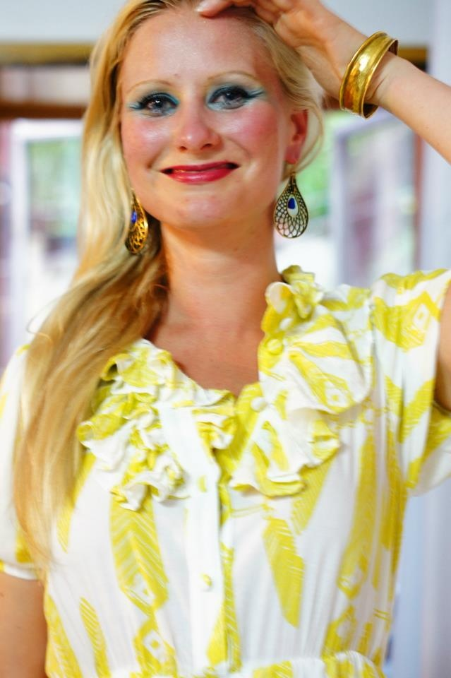 Perfect choice of makeup! The green eye shadow looks great with this bright yellow Ivana Helsinki dress. Also love her cuff and accessories. #inspiration #beauty #streetstyle