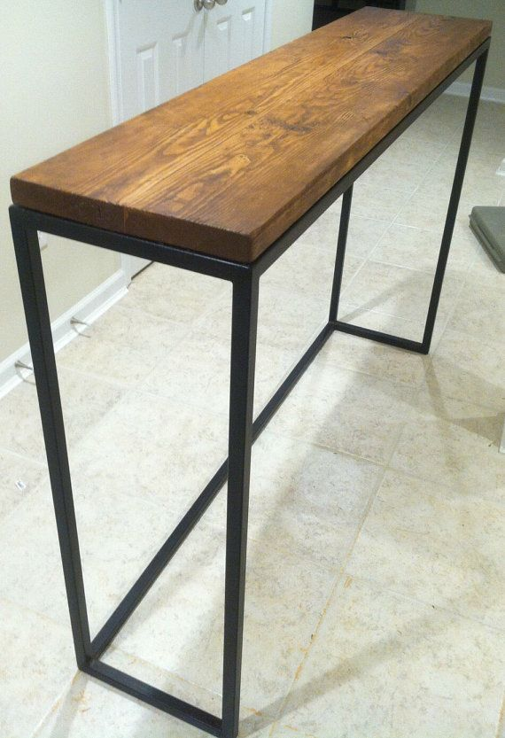 Here is a Bar Table that was Custom made for a customer in the DC area. It features a reclaimed table top, hand scraped red wood, and finished with a clear poly. The Steel frame was made to look like weathered steel or pitted cast iron through a 3 step treatment process. It was