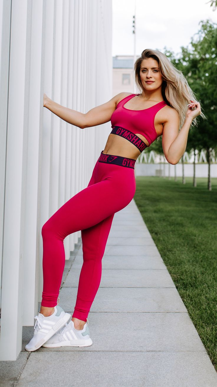 A perfect fit. Whitney Simmons styling the new Fit Sports Bra in Cranberry and Rich Purple.