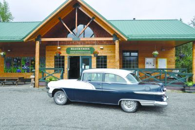 """Today, Sid sits outside the Beaver Creek Visitor Information Centre basking in the warm summer sun. As he waits for visitors to arrive, he admires the bodywork of his 1956 Pontiac in the sunlight. """"I bought the '56 in Whitehorse a few years ago."""