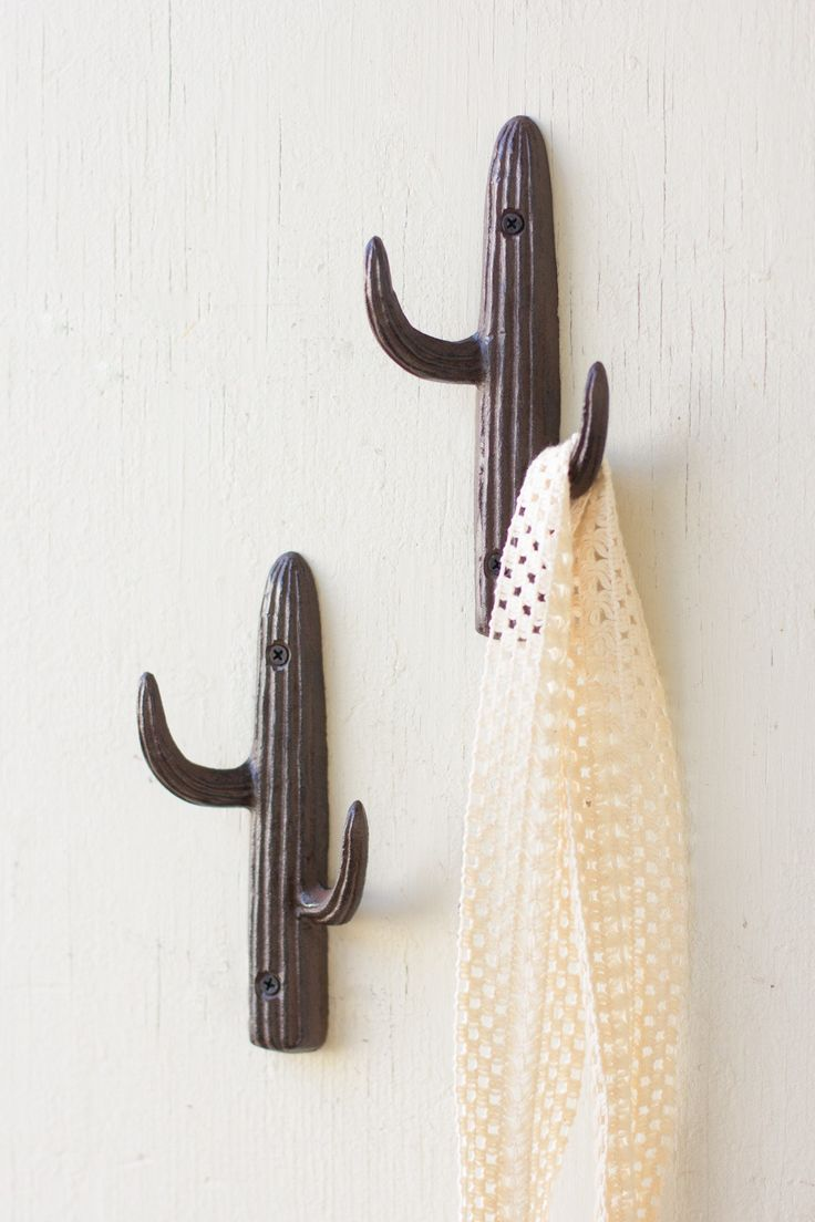 Made from cast iron, this clever wall hook will bring a Southwest vibe to any room in your home. Place it next to any entryway for a unique and convenient hook that will hold your jackets, bags, or je