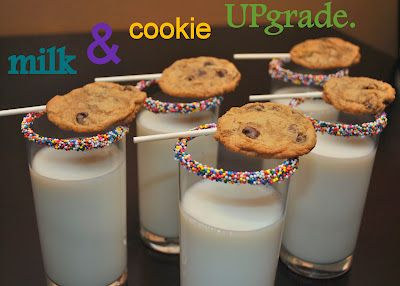 chocolate and sprinkle rimmed milk glasses with cookies on a stick for easy dipping! great for a kid or preteen party!