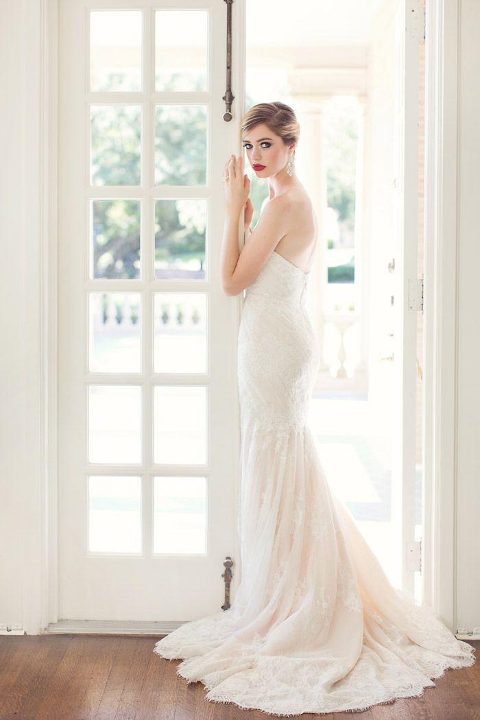 So lovely! We just adore everything about this shot. #photography #wedding #bride #dress #makeup #hair http://sarahkatephoto.com/blog/2014/01/brides-of-north-texas-cover-and-gown-shoot/