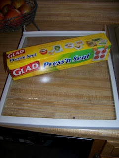 Cover the shelves in your fridge with Glad Press 'n' Seal. The next time they get dirty, just peel off the plastic wrap and replace it.