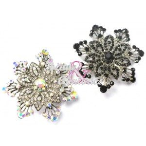 Rhinestone brooch flower-shaped 6 cm in diameter. This brooch features a pin and a linker in the   rear.