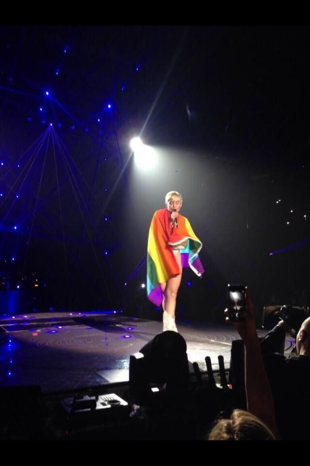Miley Cyrus Wraps Herself In A Gay Pride Flag Onstage
