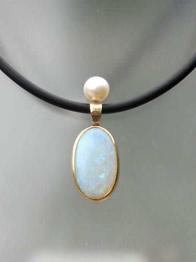 Custom made pendant with pearl and opal.