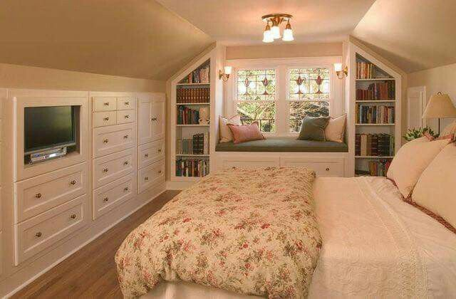 This is such a unique room - The focus on the bay window is comfy and I love the bookcases on each side but i think the bed still takes up too much of the room.