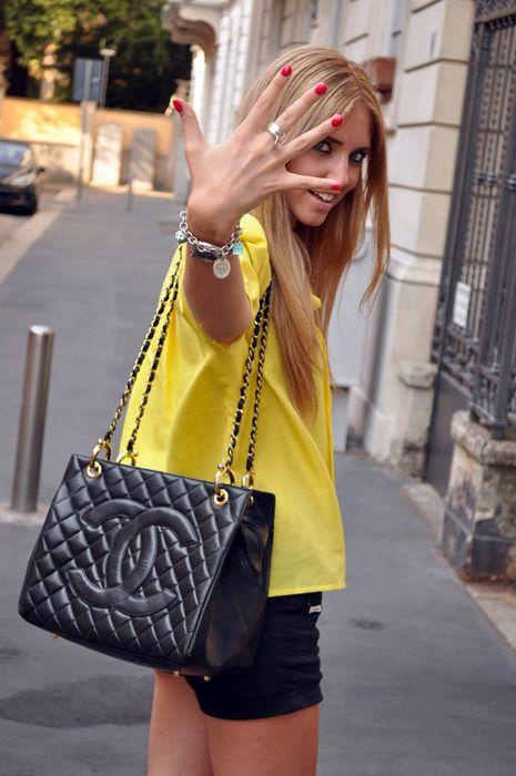yellow top. black chanel bag.