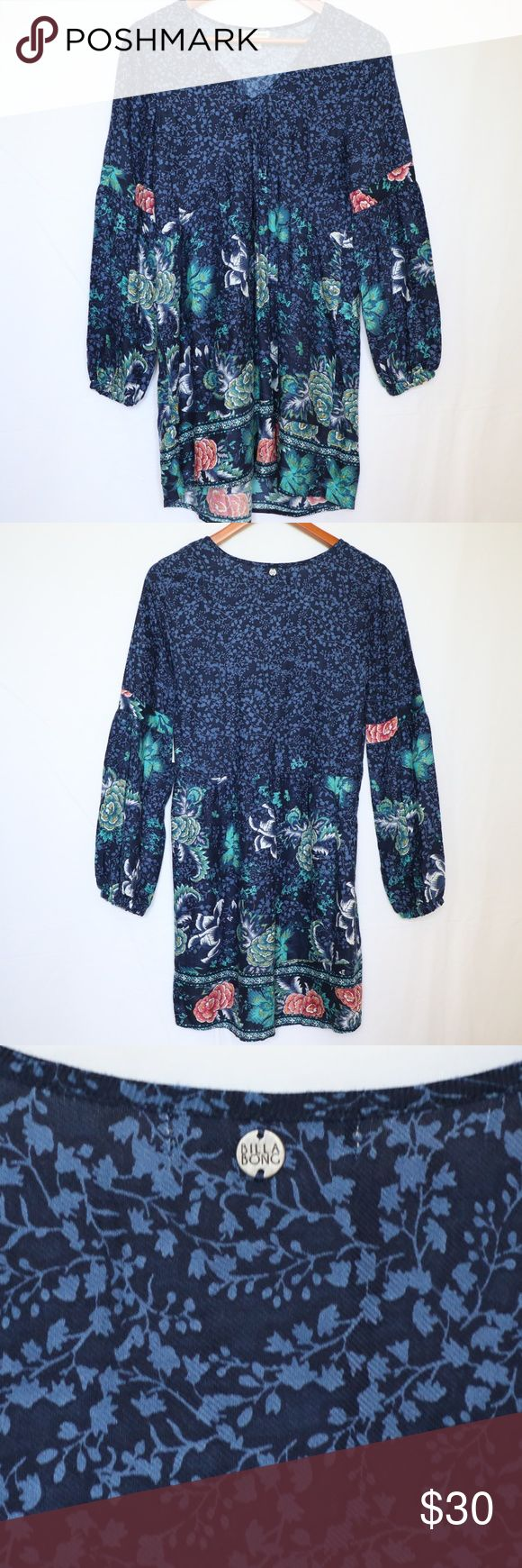 "Billabong Blue Floral Long Sleeve Tunic Dress XS Billabong Junior's Clearest Melody Long Sleeve Printed Dress XS NEW $55 Details Paisley scrolls in rich henna hues cover a romantic dress fitted with a loose,  gently gathered Empire waist and billowy drop-shoulder sleeves cinched at the wrists. - V-neck - Long sleeves with elastic cuffs - Allover print - Pleated skirt  Measurements taken with garment flat on table. Armpit to armpit: 16"" Sleeves: 24.5"" Length: 33"" Billabong Dresses"
