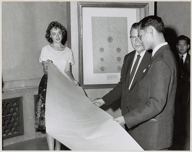 Photograph of King of Thailand Viewing Facsimiles of Early Siamese Treaty with Pat Steffing and Third Archivist of the United States Dr. Grover, 1960, via Flickr.