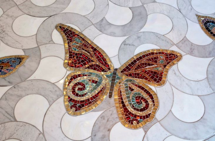 A beautiful butterfly on the SiciStone Floor in marble. The butterfly is made using Sicis artistic technique in which every single tessera has been cut and placed by hand by Sicis mosaic masters in Ravenna.