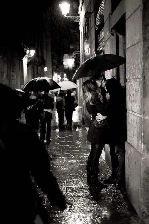 .Kissing in the rain.