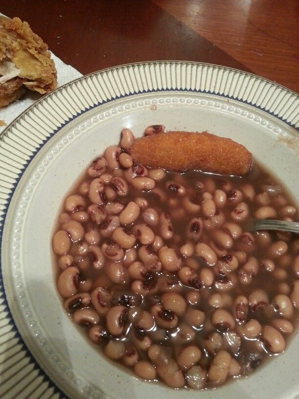 Slow-cooked black eyed peas  Seasoned with a chicken bullion and onion powder..no meat or fat seasoning..they were delish!!  Yes thats a hush puppy to go with it.
